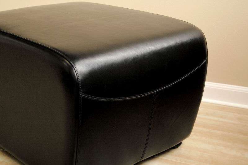 Black Full Leather Ottoman With Rounded Sides Wholesale